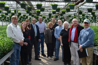 The Eelman family and guests in the greenhouses